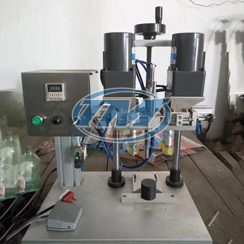 Máy xoáy nắp chai dầu gội, sữa tắm bán tự động (TMDC-DA08)